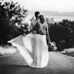 Bride showing off her altered silk chiffon wedding dress