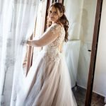 Bride in intricate hand beaded and lace detailed champagne bespoke wedding gown