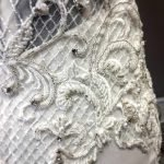 Close up of Hand Beading through the lace on Angela's bespoke bridal gown
