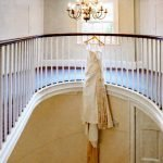 Wedding Gown Hanging from banister showing floral silk tulle