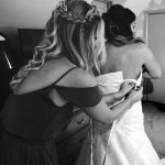Bride getting ready for her day, laced corset back