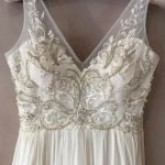 Redesigned wedding dress top half with Intricate moonstone beading and lace