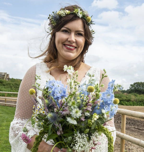Bespoke Wedding Dress Bride holding a Flower Bouquet