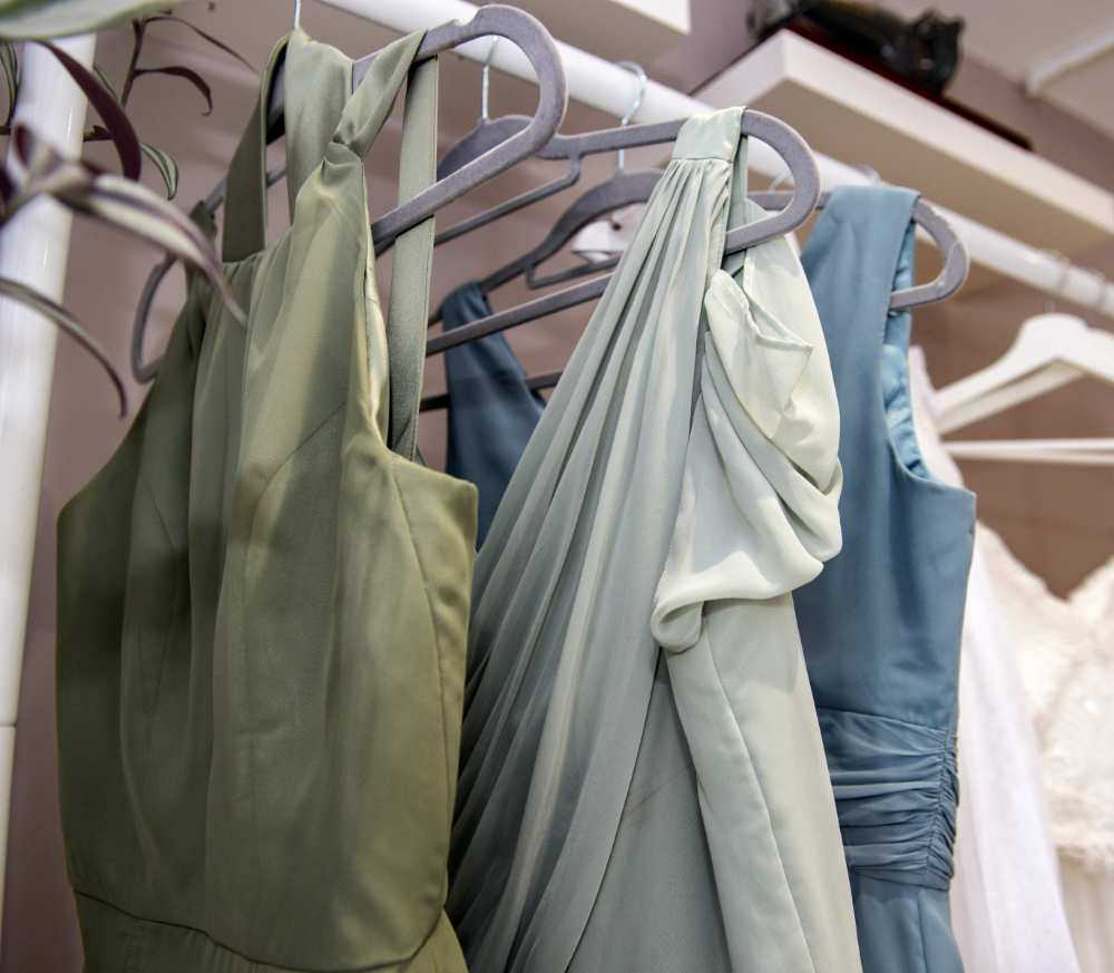 Three evening dress's on hangers ready for final fitting